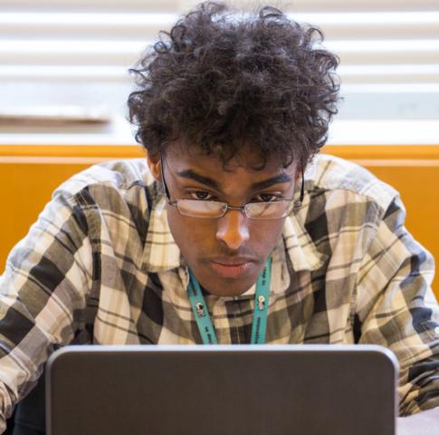 student in heavy focus