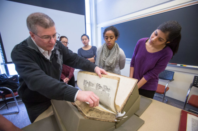 class examining historical book